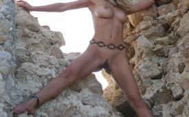 399-Athletic-goddess-naked-spread-eagle-on-rocks.jpg