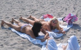 415-Braless-babes-tanning-on-the-hot-sands.jpg