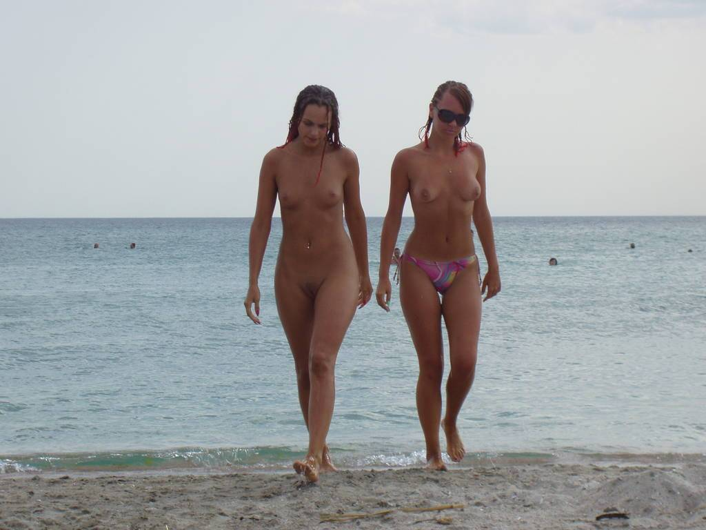 Sexy girls walking out of the water