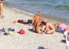 Naked couple on a nudist beach