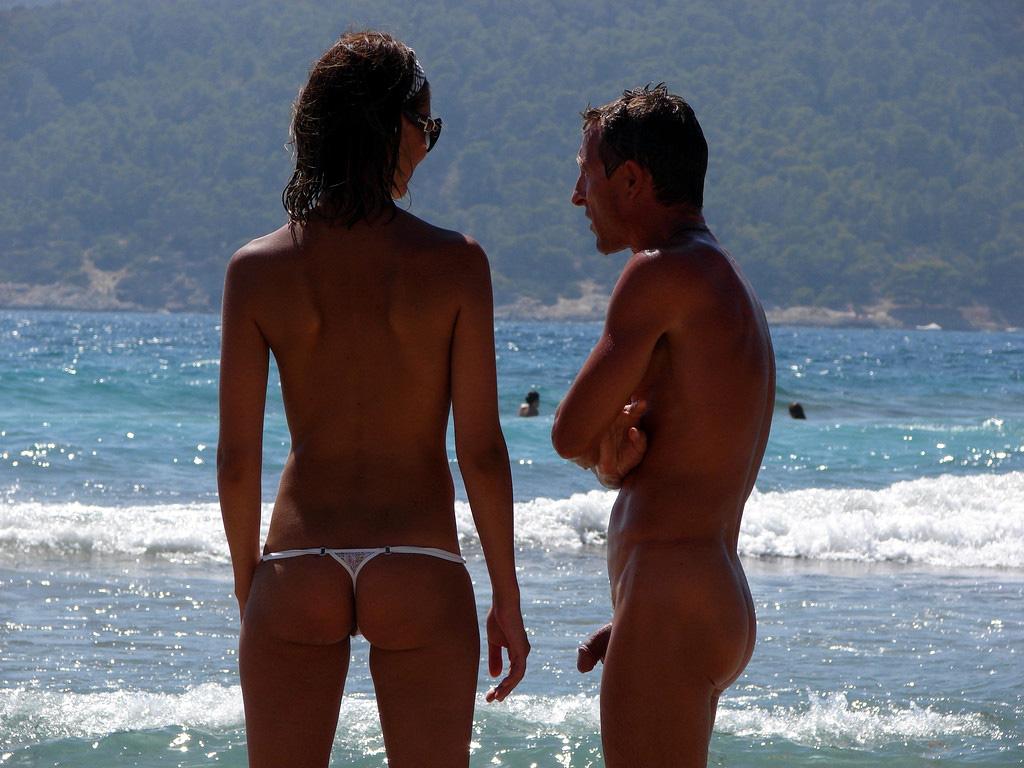 Nude guy near his topless girlfriend