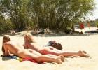 Nudist girls tanning their bottoms