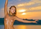 Showing off her hot body in the sunset