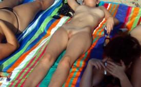 859-Sexy-slender-teen-getting-a-tan-in-the-buff.jpg