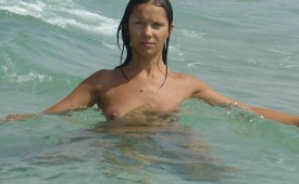 875-She-expose-her-perky-nipple-while-swimming.jpg
