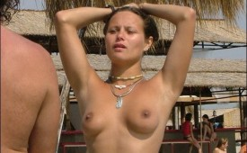 881-Topless-babe-on-a-sunny-beach.jpg