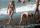 Two blonde cuties enjoying the nude beach
