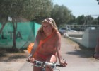 Topless hottie driving a bike